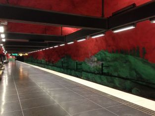 Solna Centrum metro station; the whole thing is painted in a giant mural of various periods in Swedish history